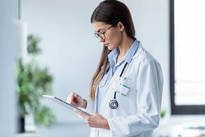 Female doctor using her digital tablet