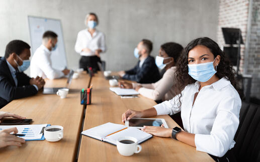 businesswoman-in-face-mask-sitting-attending-corpo-CERRTY2