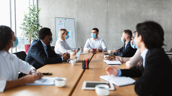 people-in-face-masks-sitting-during-corporate-meet-A4S4S5H