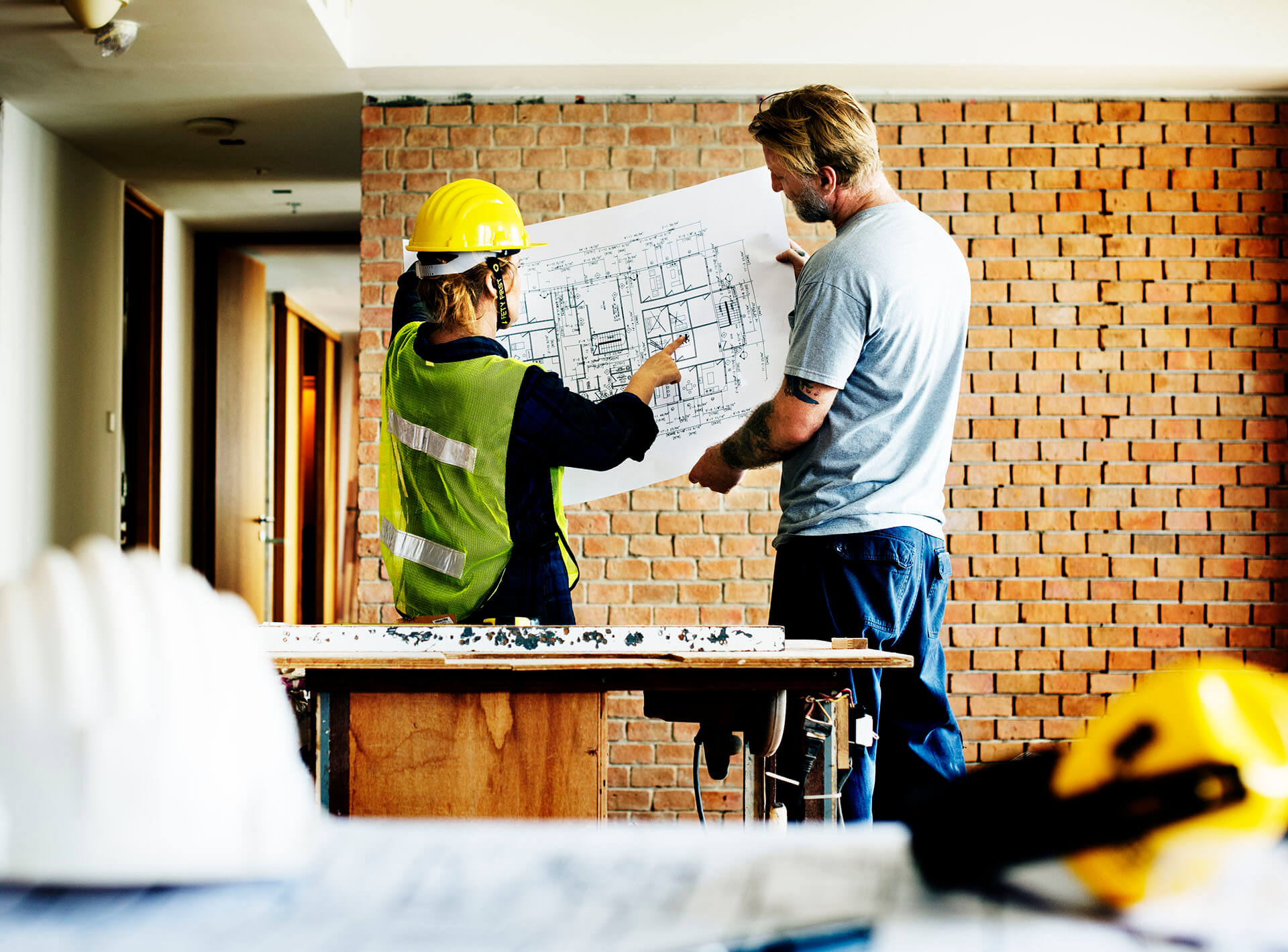 construction-team-working-on-a-blueprint-PTWBMYW-1
